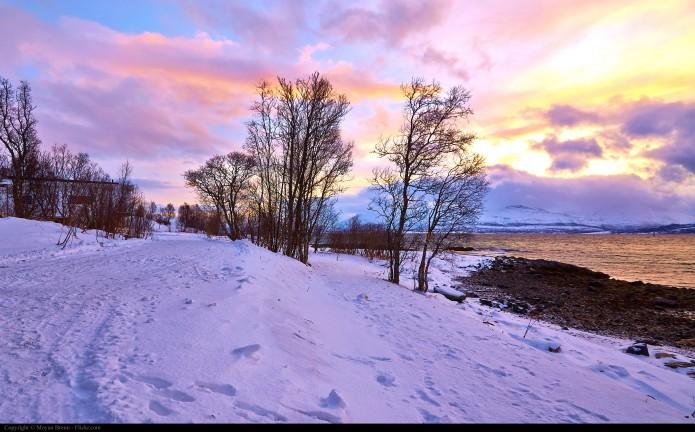 Moyan Brenn Norway snow landscape seen from the beach of Tromso